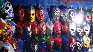 Mexican market stall selling souvenir wrestling masks in Mexico City