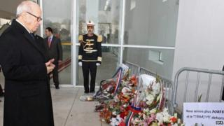 Tunisian President Beji Caid Essebsi lays a wreath in memory of those killed at the Bardo museum attack, 22 March 2014