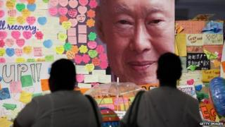 Hospital staff mourn the passing of former Prime Minister Lee Kuan Yew outside the Singapore General Hospital on 23 March 2015 in Singapore