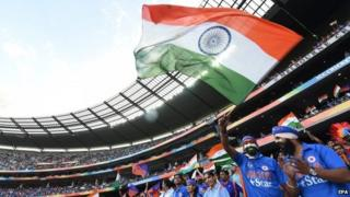 An Indian fan waves a national flag as India plays Bangladesh in the World Cup quarter-final match at the MCG in Melbourne, Australia, 19 March 2015