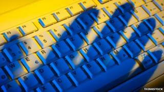 Shadow of hand on keyboard