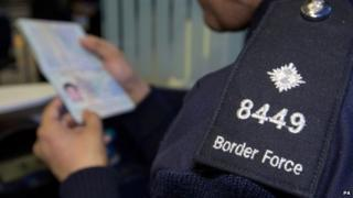 Border Force official checking passport