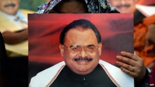 Supporters of Pakistan's Muttahida Qaumi Movement (MQM) party hold photographs of party leader Altaf Hussain as they stage a sit-in calling for his release in Karachi on June 3, 2014
