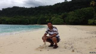 Dr Les Ala on a beach in Vanuatu
