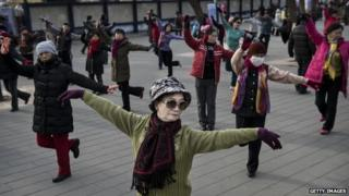 Chinese women dancing in a park