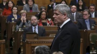 Canada's Prime Minister Stephen Harper speaks in the House of Commons on Parliament Hill in Ottawa 24 March 2015