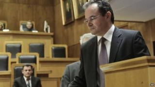 Former Greek finance minister George Papaconstantinou arrives in court on Wednesday Feb. 25, 2015