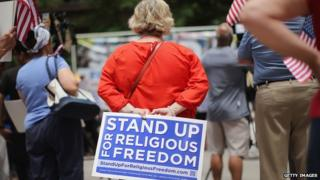 A woman protests at religious freedom rally in Chicago, Illinois