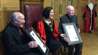 The two retired bishops received their honour on Tuesday