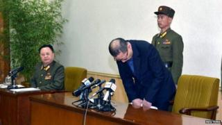 One of the two men arrested in North Korea bows during a news conference in this undated photo released by North Korea's Korean Central News Agency (KCNA) in Pyongyang on 26 March 2015