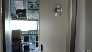 File photo showing opened door into Airbus plane cockpit
