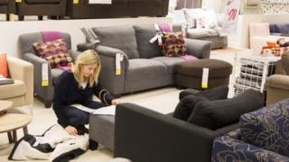 Woman shopping for sofa in IKEA, Wembley, London