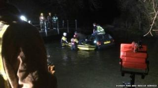 Fire crews rescue three people after their car plunged into the River Frome, near Wrackleford
