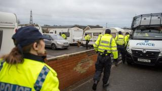 Police officers in Operation Rague raid