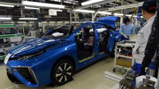 """Employees of Toyota Motors assemble the FCV """"Mirai"""" on the assembly line"""