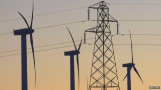 Electricity pylon and wind turbines