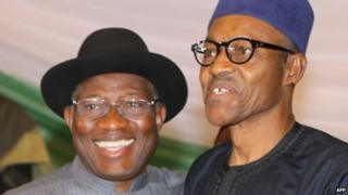 "Nigerian President Goodluck Jonathan (L) and APC main opposition party""s presidential candidate Mohammadu Buhari (R) smile after signing the renewal of the pledges for peaceful elections on March 26, 2015 in Abuja."
