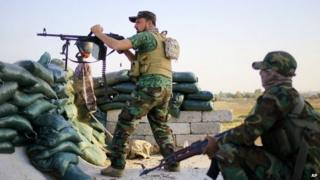 Shia militia fighters clash with IS outside Tikrit. 20 March 2015