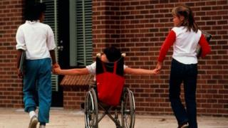 Disabled child and friends