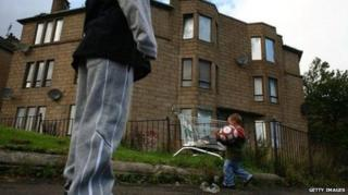 Boys playing outside a block of flats