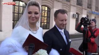 Maria Maksakova-Igenbergs and Denis Voronenkov after their wedding