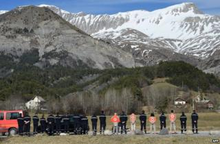 Rescue workers pay tribute to the air crash victims at Le Vernet, 27 March