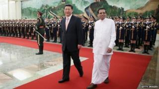 Chinese President Xi Jinping (L) accompanies Sri Lankan President Maithripala Sirisena