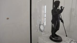 A general view shows a staute and its display case damaged when gunmen opened fire on visitors to the National Bardo Museum, Tunis, Tunisia