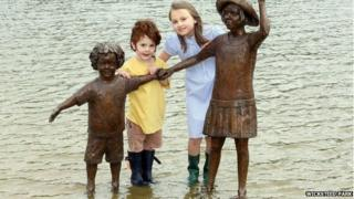 Megan Phillips and Victor Groves with sculpture at Wicksteed Park