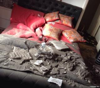 Ceiling debris lying on a bed