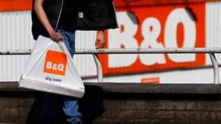 Shoppers walking past a B&Q store