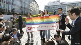 Lesbian activists Hiroko Masuhara (centre L) and her partner Koyuki Higashi (centre R) speak to the media with transgender activist Fumino Sugiyama (L) and gay activist Gon Matsunaka after Tokyo's Shibuya ward recognises same-sex partnerships, outside the Shibuya city hall in Tokyo in this photo taken by Kyodo 31 March 2015