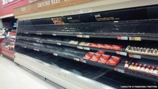 Bare shelves in the meat aisle of a Canadian supermarket