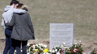 Relatives of the victims of the air crash visit the memorial in Le Vernet, south-eastern, France, 30 March 2015