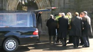 The coffin arrives at the Priory Church