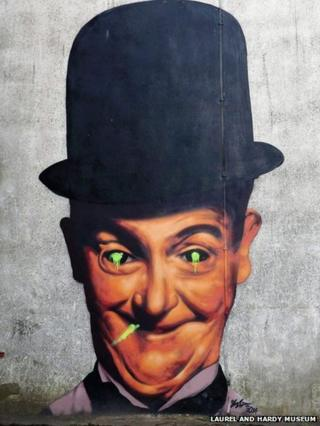 The vandalised painting of Stan Laurel