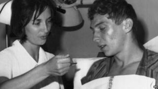 Brian Robson being nursed in Los Angeles in 1965