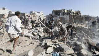 People search for survivors under the rubble of houses destroyed by an air strike near Sanaa Airport (25 March 2015)