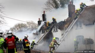 Firefighters tackling thatched roof blaze