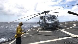 Sea Hawk on the rolling deck of USS Anzio