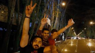 Iranians celebrate in the street of Tehran after the agreement was announced