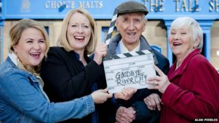 Actor Johnny Beattie with co-stars of River City on his last day of filming.