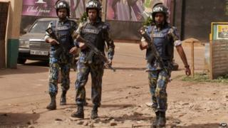 The nightclub, rear, that was attacked by gunmen as armed forces provide security in Bamako, Mali, Saturday, March 7, 2015.