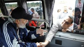 Official handout picture of Fidel Castro greeting a member of the Venezuelan delegation II flight Solidarity Bolivar-Marti who are in Cuba taking part in social and political activities, in Havana on March 30, 2015.