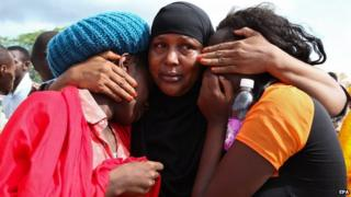 Some of the Garissa University students who were rescued comfort each other at the Garissa military camp on 3 April 2015