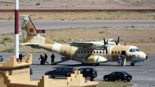 A military plane arrives from the Moroccan capital Rabat at an airport in Ouarzazate on April 5, 2015 during the rescue operation for the Spanish cavers found in Morocco's High Atlas mountains