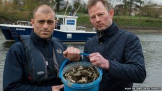 Jason Davey (rt) with a member of staff from the Port of London Authority who collected the razor blades