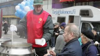 People being given soup at a campaign event in Finland