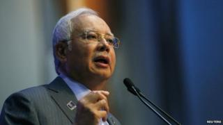 Malaysian Prime Minister Najib Razak speaks at a news conference to announce budget revisions to help its oil exporting economy adjust to the impact of slumping global crude prices, in Putrajaya on 20 January 2015