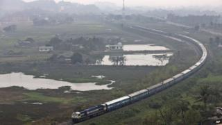 An Indian railways train moves through a track on the outskirts of Gauhati, north-eastern Assam state, India, Thursday, Feb. 26, 2015.
